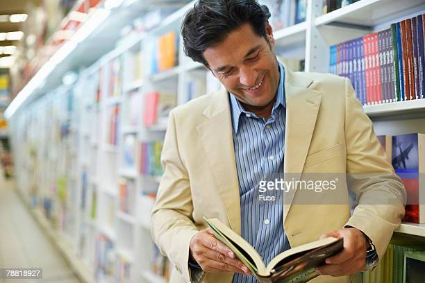 Man Reading in Bookstore