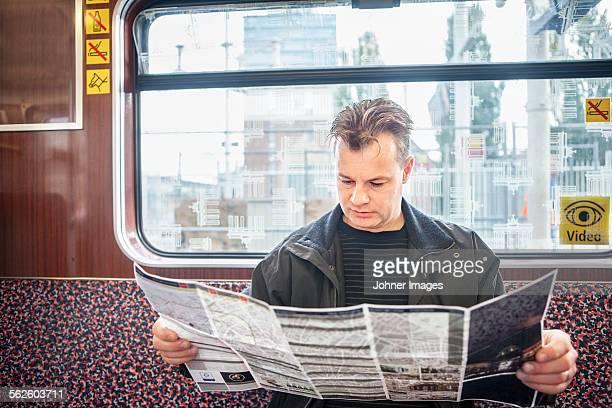 Man reading map in train