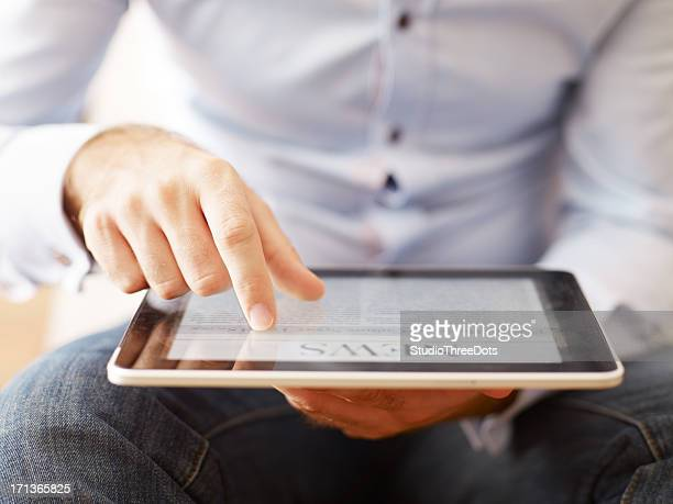 man reading news on the digital tablet