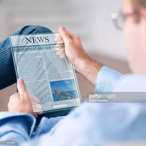 man reading news on the futuristic digital tablet