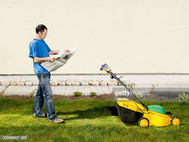 Man reading newspaper in garden, invisible person mowing grass with landmower (digital composite)