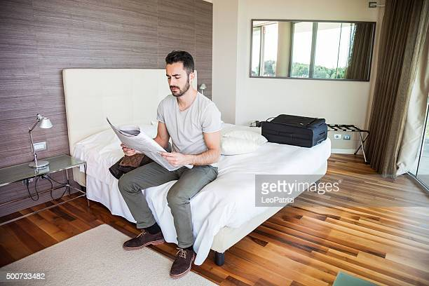 Man reading newspaper in the morning
