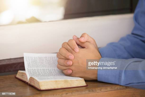A man reading the Holy Bible.