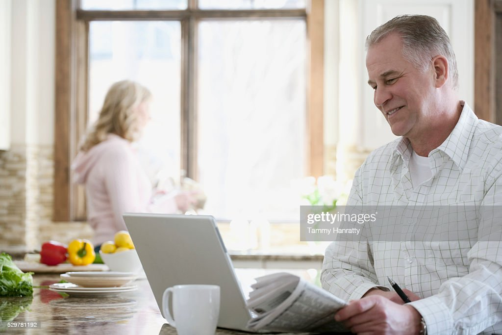 Man reading the news in the morning : Stock Photo