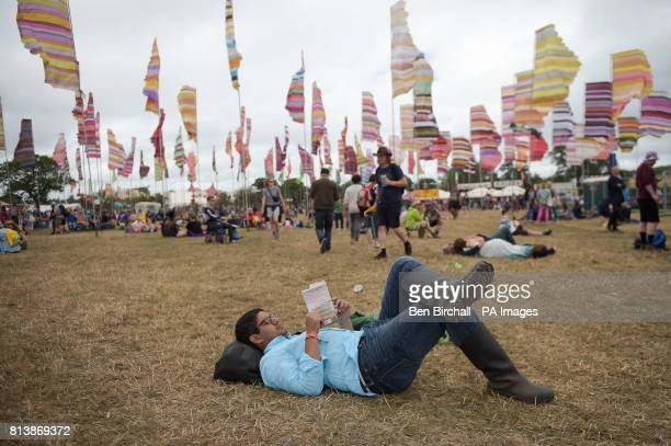 A man reads a book in West Holts at Glastonbury Festival Worthy Farm Somerset PRESS ASSOCIATION Photo Picture date Sunday June 2017 Photo credit...
