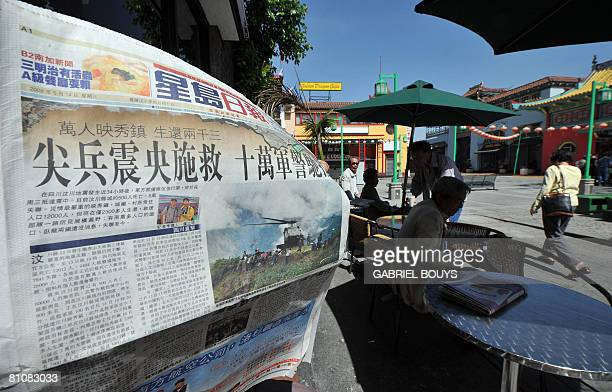 A man reads a Chinese language newspaper on May 14 in the Chinatown section of Los AngelesCalifornia after the massive earthquake that hit China on...