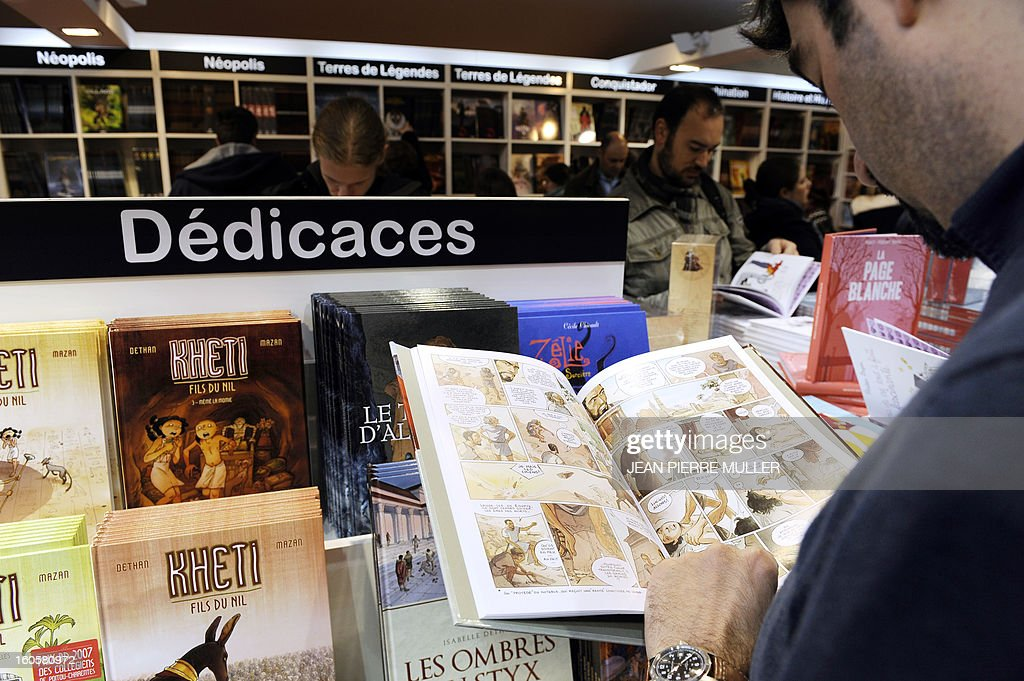 A man reads a comic book on the last day of the Comic book festival of Angouleme on February 3, 2013 in Agouleme, western France. The awards ceremony will take place today.
