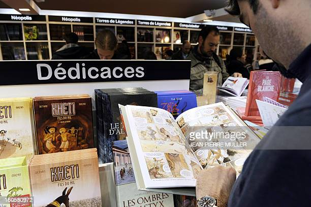 A man reads a comic book on the last day of the Comic book festival of Angouleme on February 3 2013 in Agouleme western France The awards ceremony...