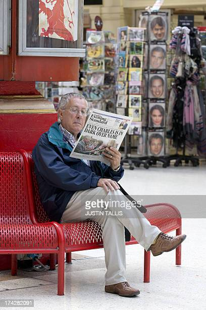 A man reads a free London newspaper giving news of the birth of a new royal baby in a convenience store in London on July 23 2013 International...