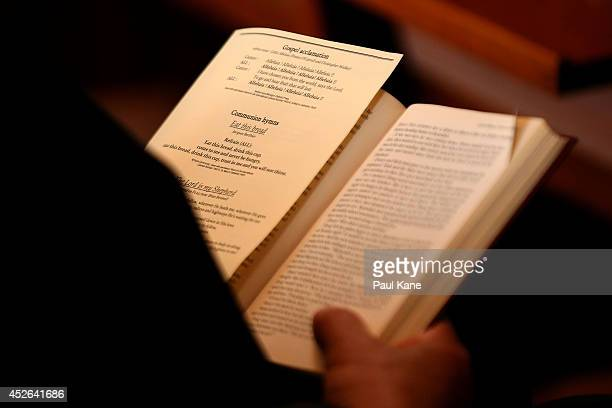 A man reads a hymn book during a memorial service held for victims of the MH17 disaster at St Mary's Cathedral on July 25 2014 in Perth Australia 7...