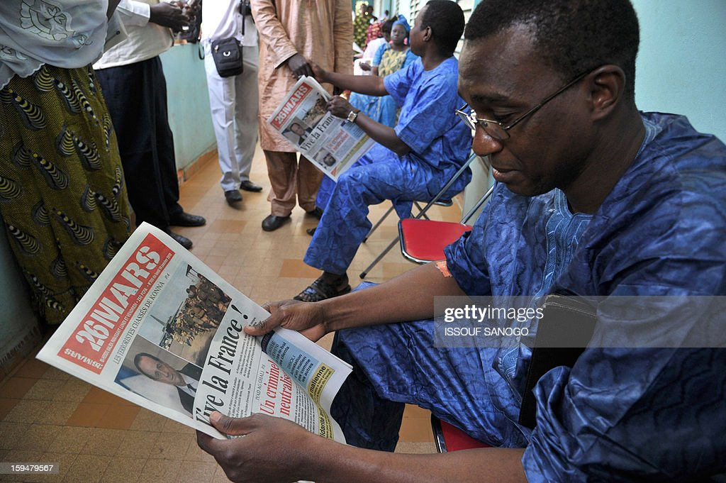 A man reads a local newspaper reading ''Long live France!'' referring to France's military intervention as he waits to donate blood, on January 14, 2013 in Bamako. Islamists have retreated in the east of Mali but French forces are facing a difficult situation in the west of the country where rebels are well armed, French Defence Minister Jean-Yves Le Drian said on January 14. France launched the operation alongside the Malian army on January 11, 2013 to counter a push south by the insurgents who had threatened to advance on the capital Bamako. AFP PHOTO / ISSOUF SANOG0