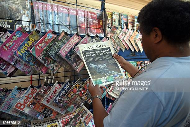 A man reads a local newspaper with an image of the plane that crashed in the Colombian mountains with the Brazilian team Chapecoense Real on board in...