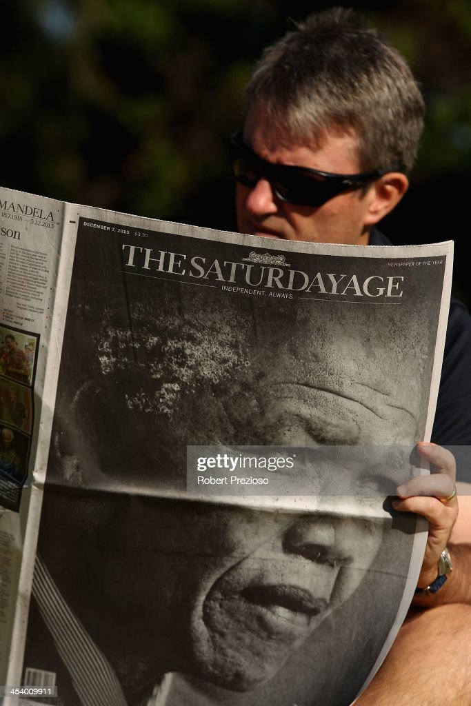 A man reads a newspaper after the death of Nelson Mandela on December 7, 2013 in Melbourne, Australia. Mandela was a leader that helped conquer apartheid in racially divided South Africa after being jailed for his activism for decades. He was South Africa's first black president. He died yesterday at the age of 95.