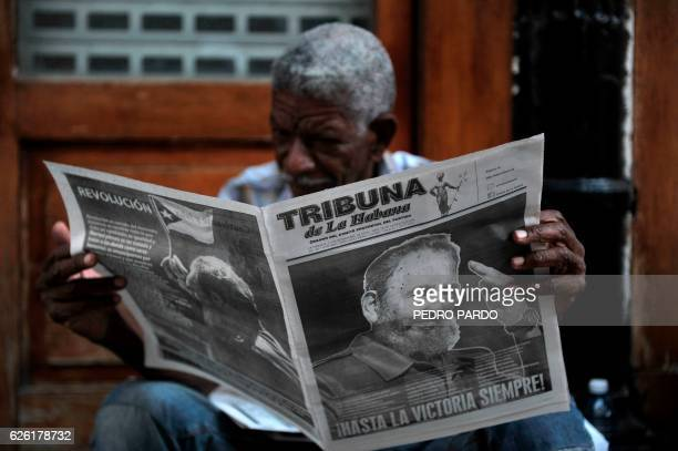 TOPSHOT A man reads a newspaper in a street of Havana on November 27 two days after Cuban revolutionary leader Fidel Castro died Cuban revolutionary...