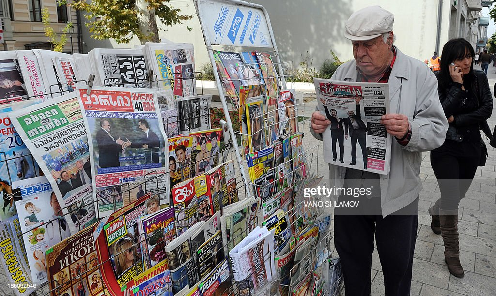 OCTOBER 28, 2013 -- A man reads a newspaper in Georgia's capital Tbilisi, on October 28, 2013, the next day after the presidential election. A loyalist of Georgia's billionaire Prime Minister Bidzina Ivanishvili basked today in his presidential election victory to replace pro-Western moderniser Mikheil Saakashvili after a decade in charge of the ex-Soviet nation.