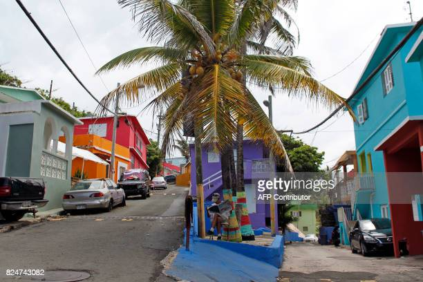 A man reads a newspaper in the neighbourhood of La Perla where the video 'Despacito' was recorded in San Juan on July 22 2017 Something unusual is...