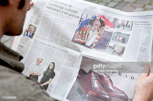 A man reads a newspaper the day after the birth of the son of Prince William Duke of Cambridge and Catherine Duchess of Cambridge on July 23 2013 in...