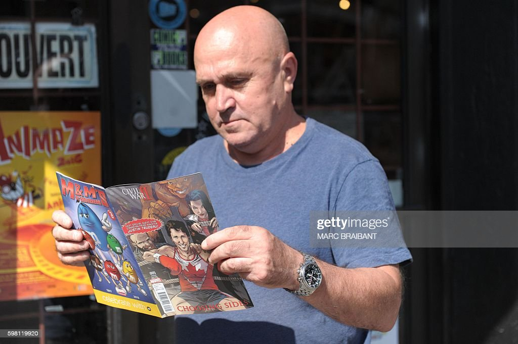 A man reads a variant edition of the Marvel's comic book featuring Canadian Prime Minister Justin Trudeau as a super hero in front of a newstand in...