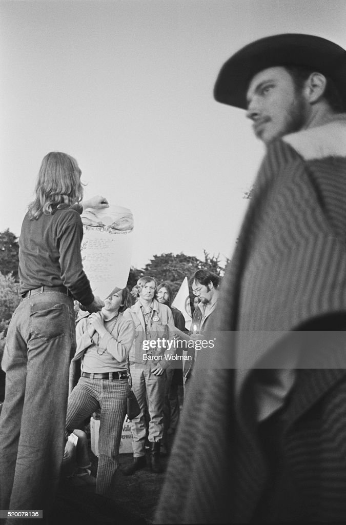 A man reads aloud the 'Hymn of Death and Resurrection' during the 'Hippie Sunrise' a gathering taken place at Buena Vista park during sunrise on...