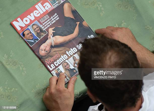 A man reads an Italian magazine with photos of Noemi Letizia and Italian Prime Minister Silvio Berlusconi on the cover on May 26 2009 in Rome...