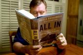 A man reads biographer Paula Broadwell's book 'All In The Education of General David Petraeus' in Manassas Virginia on November 13 2012 Petraeus'...