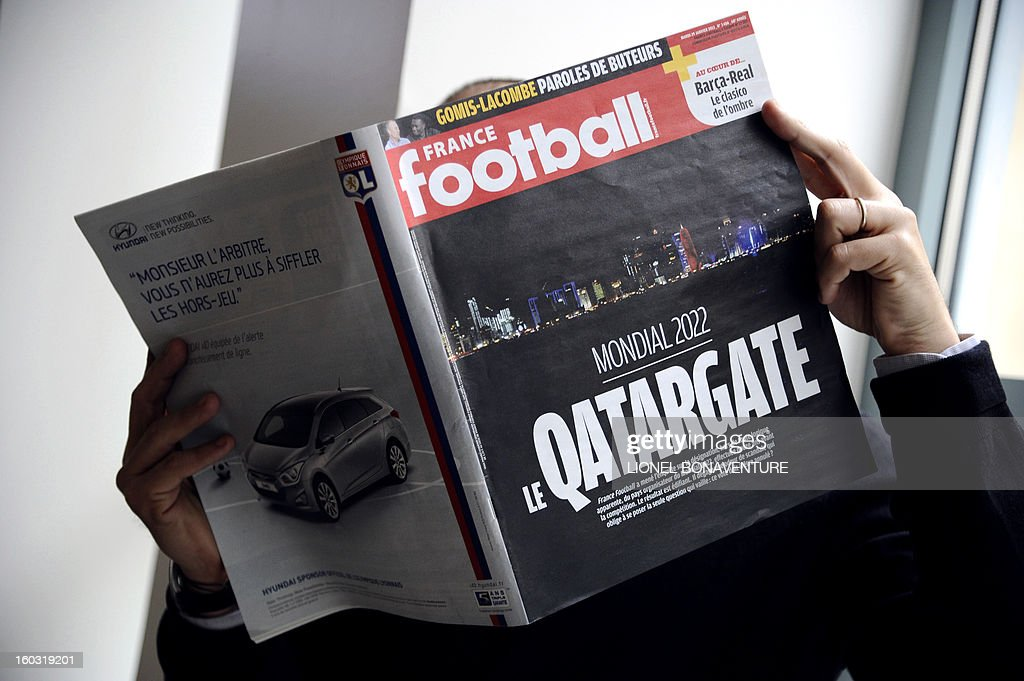"A man reads French football magazine 'France Football' with the 'Qatargate' in front page on January 29, 2013 in Paris. The magazine pretends in his last issue that in December 2010 Qatar bought the votes of FIFA executives and won the bid for the 2022 World Cup against such strong opponents as the US, South Korea, Japan and Australia. In 2010, Qatar spent $1.25 million on CAF's congress to win the four votes of FIFA's African executives. In addition, the then President Nicolas Sarkozy asked UEFA president Michel Platini to support Qatar's bid for ""geopolitical reasons."" France Football alleged that President Sarkozy and Michel Platini then met with Qatar's Crown Prince Sheikh Tamim Bin Hamad Al Thani to discuss Qatar's future investments into French football. France Football said it is going to submit the evidence to FIFA. BONAVENTURE"