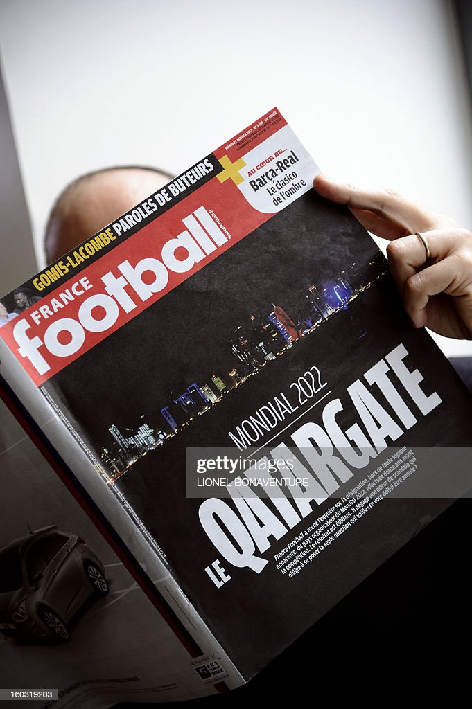 """A man reads French football magazine 'France Football' with the 'Qatargate' in front page on January 29, 2013 in Paris. The magazine pretends in his last issue that in December 2010 Qatar bought the votes of FIFA executives and won the bid for the 2022 World Cup against such strong opponents as the US, South Korea, Japan and Australia. In 2010, Qatar spent $1.25 million on CAF's congress to win the four votes of FIFA's African executives. In addition, the then President Nicolas Sarkozy asked UEFA president Michel Platini to support Qatar's bid for """"geopolitical reasons."""" France Football alleged that President Sarkozy and Michel Platini then met with Qatar's Crown Prince Sheikh Tamim Bin Hamad Al Thani to discuss Qatar's future investments into French football. France Football said it is going to submit the evidence to FIFA. BONAVENTURE"""
