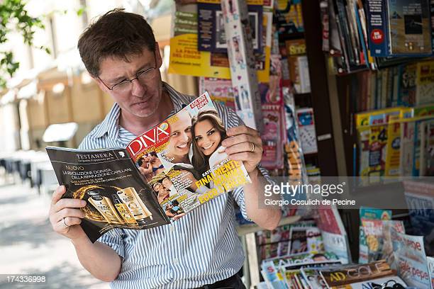A man reads magazine 'Diva' at a newstand where front pages of Italian newspapaers and magazines feature photographs of Prince William Duke of...