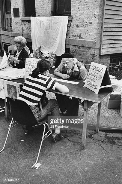 A man reads tarot cards for a customer at a block party in New York City 1976