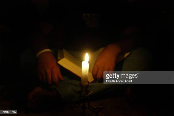A man reads the Bible during the evening prayers in the Monastery of St Moses the Abyssinian May 19 2005 east of Nebek Syria The 11th century Syrian...