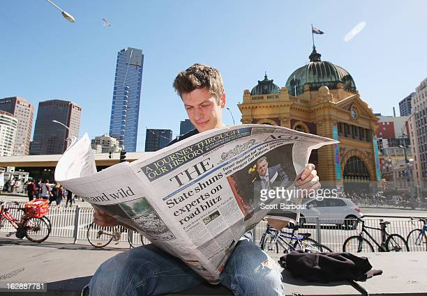 A man reads the broadsheet format 'The Age' newspaper at Federation Square on March 1 2013 in Melbourne Australia Fairfax today published its final...