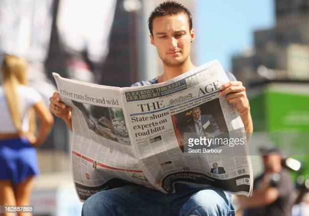 A man reads the broadsheet format 'The Age' newspaper at Federation Square on March 1 2013 in Melbourne Australia After 180 years the Monday to...