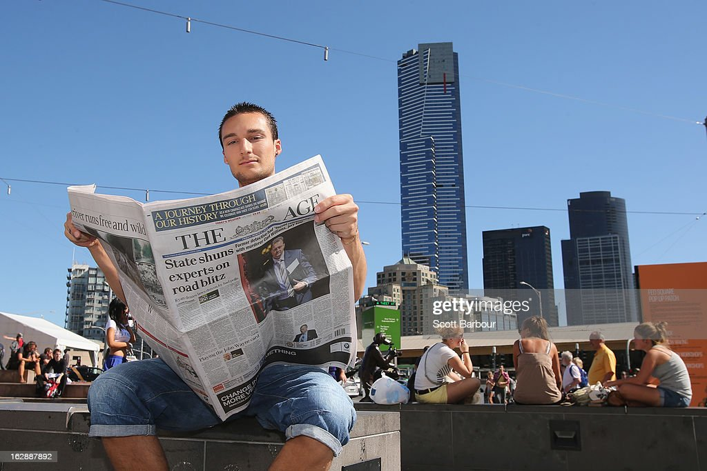 A man reads the broadsheet format 'The Age' newspaper at Federation Square on March 1, 2013 in Melbourne, Australia. After 180 years, the Monday to Friday editions of the Fairfax Media publications, The Sydney Morning Herald and The Melbourne Age will switch from broadsheet sized newspapers to compacts or tabloid sized newspapers on March 4, 2013.