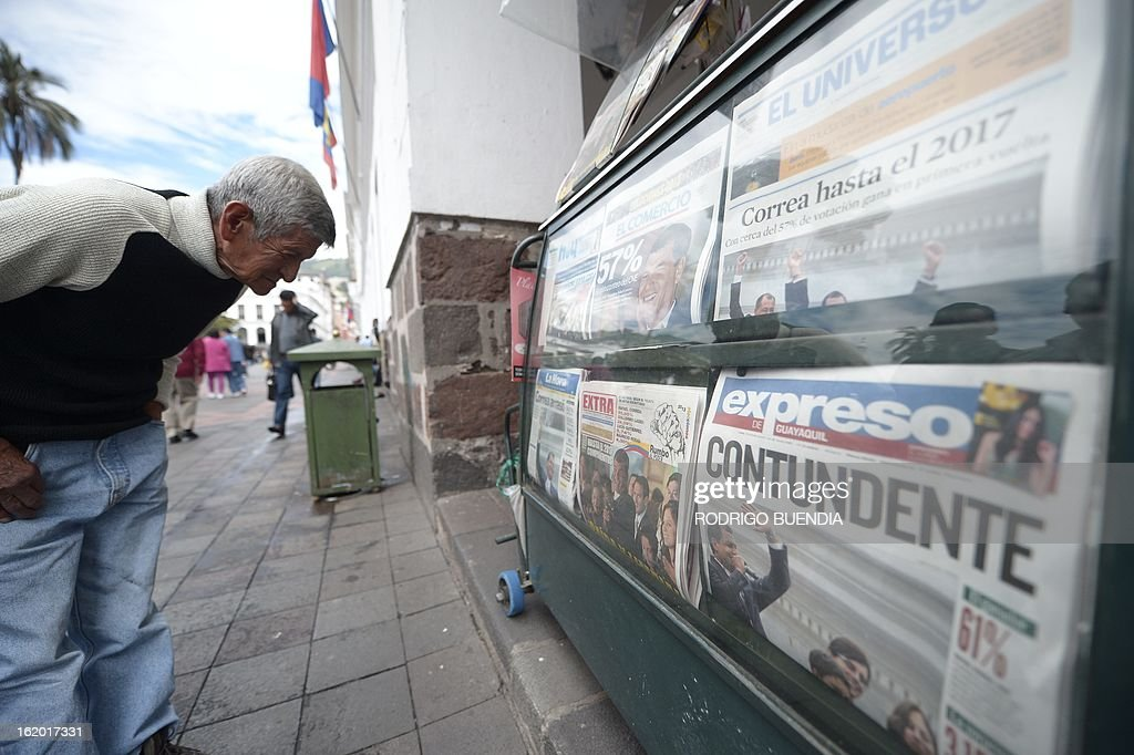 A man reads the front pages of newspapers a day after Ecuadorean President Rafael Correa was reelected, at a newsstand in Quito on February 18, 2013. Fresh from a landslide re-election victory, President Rafael Correa hoped Monday to match it with a sweeping legislative win needed to clear the way for deeper socialist changes in Ecuador.