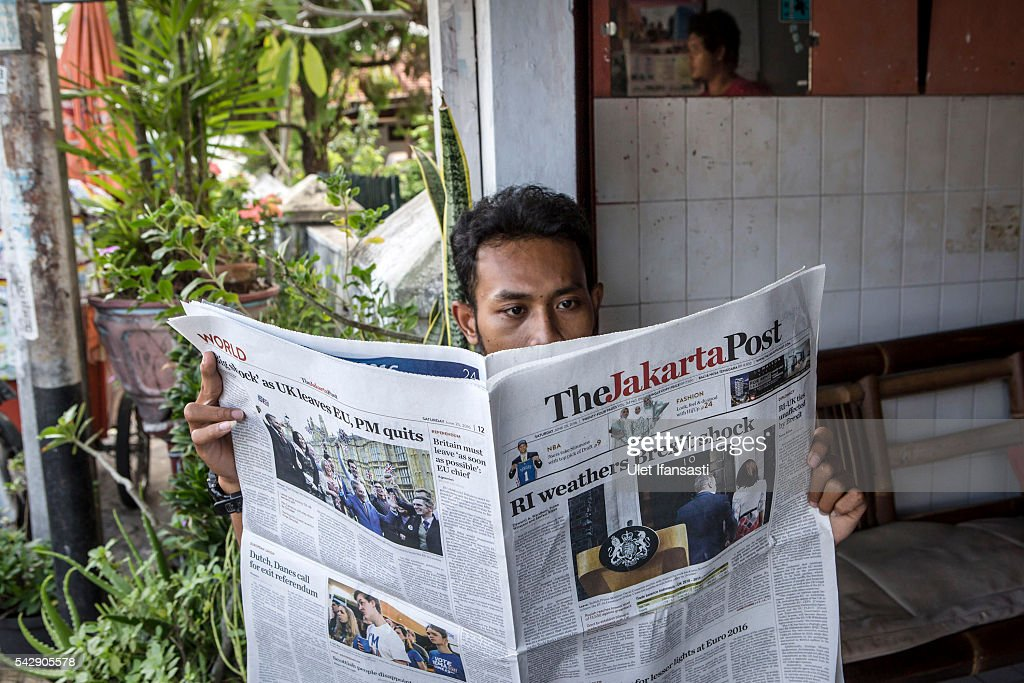 A man reads the Indonesian newspaper The Jakarta Post which shows the cover headline which reads 'RI weathers Brexit shock', on June 25, 2016 in Yogyakarta, Indonesia. The results from the historic EU referendum has now been declared and the United Kingdom has voted to LEAVE the European Union.
