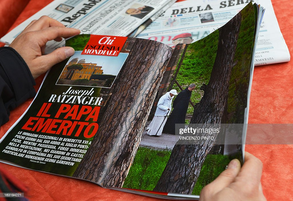 A man reads the Italian gossip magazine 'Chi' with paparazzi pictures of retired 'pope emeritus' Benedict XVI at a cafe terrace on March 6, 2013 in Rome. Italian gossip magazine Chi on Wednesday published paparazzi pictures of retired 'pope emeritus' Benedict XVI as he strolled in the grounds of the papal summer palace of Castel Gandolfo near Rome.