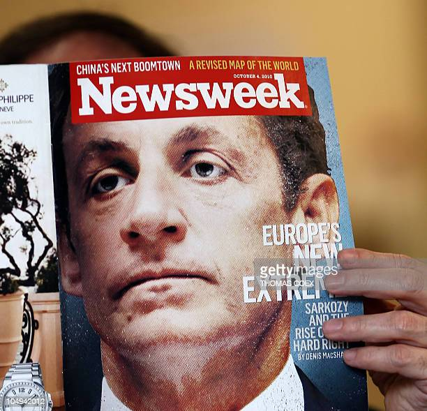 A man reads the October 4 2010 issue of the US weekly magazine Newsweek with the headline 'Europe's New Extreme' and a portrait of French President...
