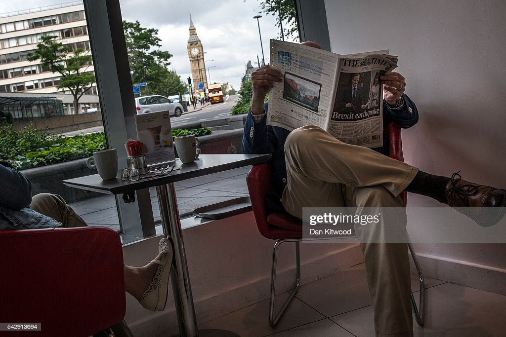 A man reads 'The Times' Newspaper in a hotel lobby the day after the majority of the British public voted to leave the European Union on June 25, 2016 in London, England. The ramifications of the historic referendum yesterday that saw the United Kingdom vote to Leave the European Union are still being fully understood. The Labour leader, Jeremy Corbyn, who is under pressure from within his party to resign has blamed the 'Brexit' vote on 'powerlessness', 'austerity' and peoples fears over the issue of immigration.