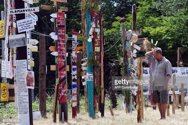 A man reads totems with various slogans during a twoday meeting organised by opponents to a controversial international airport project in the area...