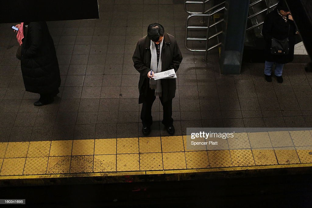 A man reads while waiting for a subway at a Manhattan station on January 29, 2013 in New York City. The city has been experiencing a rash of high-profile incidents involving individuals being hit by trains in suicides, accidents and people being pushed to their deaths. Lawmakers are planning to discuss the recent deaths while also seeking ideas for more safety on the tracks. The New York City subway system, with 468 stations in operation, is the most extensive public transportation system in the world. It is also one of the world's oldest public transit systems, with the first underground line of the subway opening on October 27, 1904.