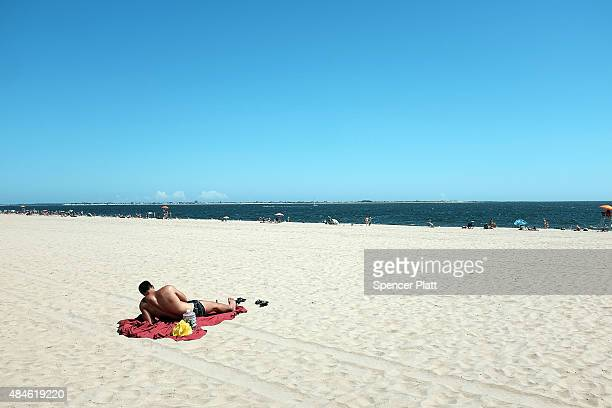 A man realaxes at Brighton Beach in Brooklyn on a hot day on August 20 2015 in New York City The National Oceanic and Atmospheric Administration...