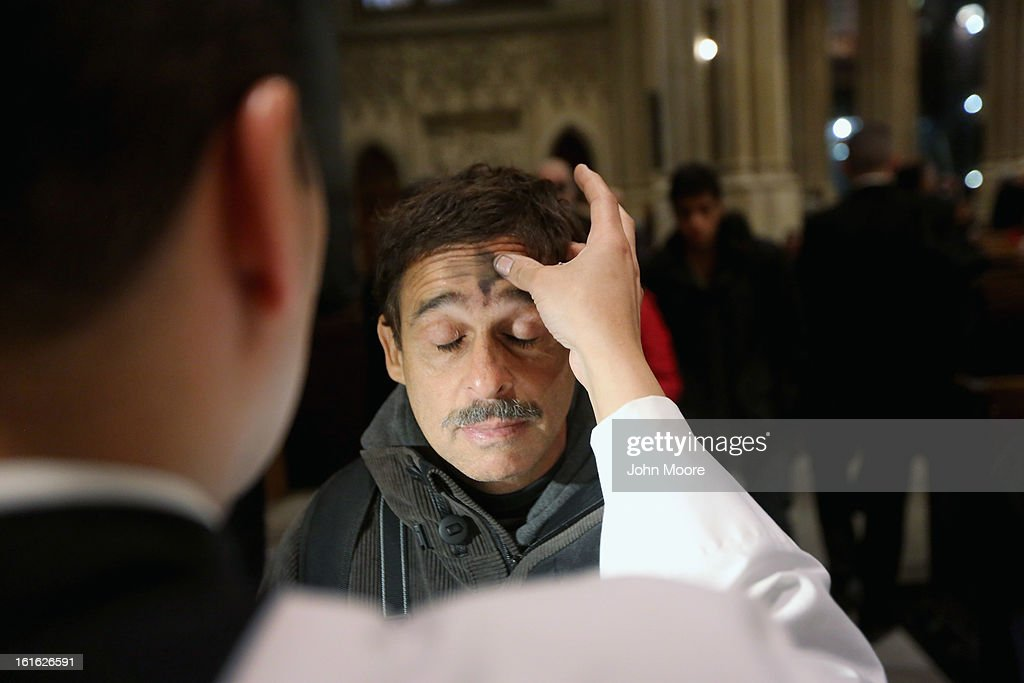 A man receives a cross of black ashes on his forehead on Ash Wednesday at St. Patrick's Cathedral on February 13, 2013 in New York City. Ash Wednesday marks the beginning of Lent, a 40-day period of pray and fasting for many Christians.