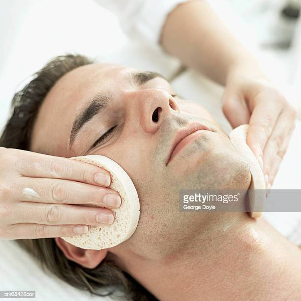 man receiving a facial