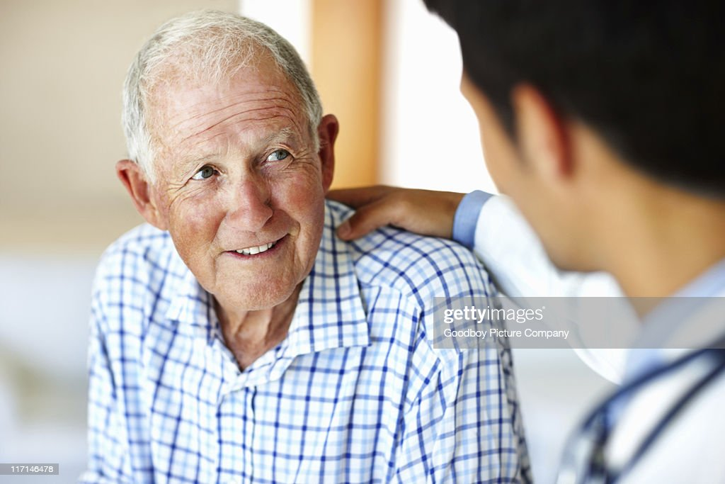 Man receiving advice from doctor : Stock Photo