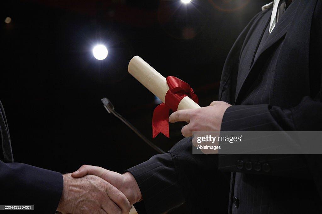 Man receiving award, close-up : Stock Photo