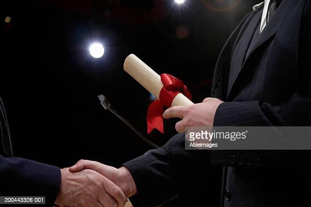 Man receiving award, close-up