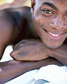 Man receiving back massage, smiling, portrait, close-up