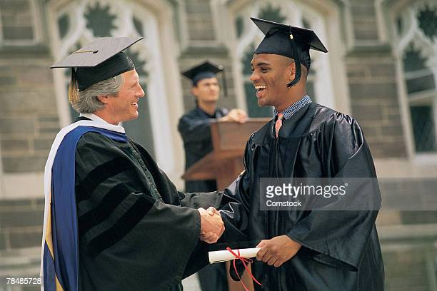 Man receiving diploma
