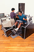 Man receiving physical therapy at gym, elevated view