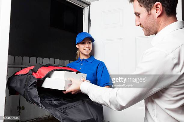 Man Receiving Pizza from a Delivery Girl